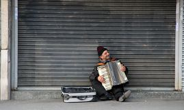 Acordian player Manchester. Man playing accordian in Manchester Royalty Free Stock Images