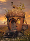 Acorn cottage with ivy. Fantasy acorn cottage with ivy on a colorful flowering meadow Royalty Free Stock Images