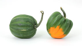 Acorn squash. Two acorn squash arranged on a white background Royalty Free Stock Image
