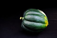 Acorn squash presented on plain black background. Stock Photo