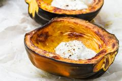 Acorn squash with sour cream Royalty Free Stock Images
