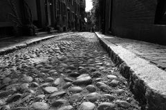 Acorn Street Early America. Child's eye view of one of the original cobblestone streets in america, Acorn Street in Beacon Hill in Boston Stock Photo