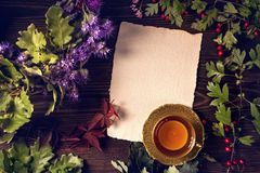 Acorn wreath and a cup of tea. On a wooden background royalty free stock image