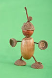 Acorns. Figure man acorns- macro toys Stock Photo