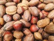 Acorns, nuts and almonds. Tomat mix of acorns, nuts and almonds, agriculture, harvest, food. Fruit Stock Photo