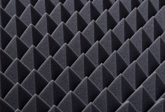 Acoustic absorbing foam for studio recording. Pyramid shape. Grey color Stock Photography