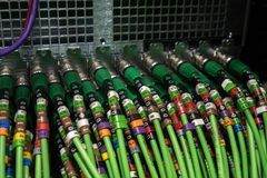 Acoustic audio cable server. Green audio cable. Many acoustic cables. Сoaxial cable for data transmission server. Close up. Acoustic audio cable server. Green Royalty Free Stock Photos