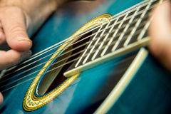 Acoustic Blue. Blue acoustic nylon string guitar being played Stock Photography
