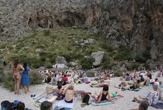 Acoustic choir singing concert at Torrent de Pareis in the spanish island of mallorca. People enjoy watching a live peformance by voices choir Capella Royalty Free Stock Image