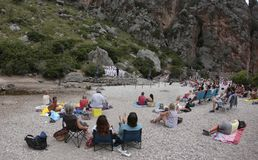 Acoustic choir singing concert at Torrent de Pareis in the spanish island of mallorca view. People enjoy watching a live peformance by voices choir Capella Royalty Free Stock Photography