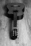 Acoustic classic guitar on a wooden floor Stock Images