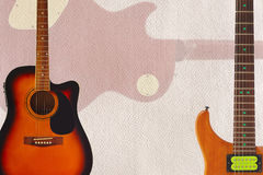Acoustic and electric guitars and back of guitar body on cardboard background, with plenty of copy space. Acoustic and electric guitars and back of guitar body Royalty Free Stock Photos