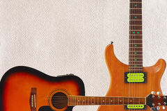 Acoustic and electric guitars on cardboard background, with plenty of copy space. Royalty Free Stock Photo