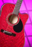 Acoustic Electric Red Guitar On Pink