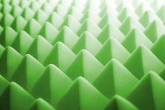 Acoustic foam - green. Tetrahedron shaped foam stock image