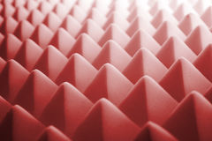 Acoustic foam - red. Tetrahedron shaped foam stock photography