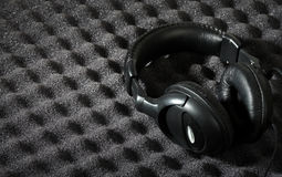 Acoustic foam wall and headphone Stock Photos