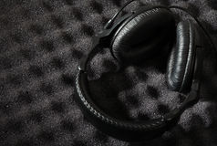 Acoustic foam wall and headphone Royalty Free Stock Photos