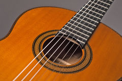 Acoustic gitar. Detail of acoustic guitar with strings royalty free stock photos