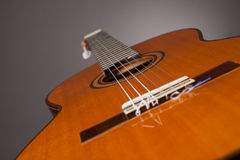 Acoustic gitar. Detail of acoustic guitar with strings royalty free stock image