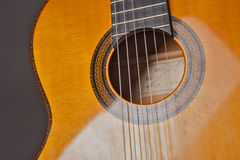Acoustic gitar. Detail of acoustic guitar with strings stock image