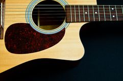 Acoustic Guitar. Partial Body Shot Stock Image