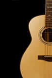 Acoustic Guitar. Shown against a black background Royalty Free Stock Photography