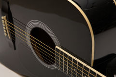 Acoustic guitar. Isolated over white Stock Photos