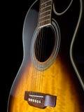 Acoustic guitar. Against black background, closeup shot Royalty Free Stock Image
