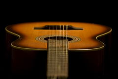 Acoustic guitar. On the dark background royalty free stock photo