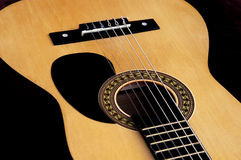 Acoustic Guitar. With dark background Royalty Free Stock Photo