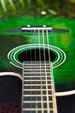 Acoustic guitar. With green grass background Stock Images