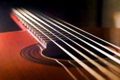 Acoustic guitar. Fretboard of acoustic guitar. Dark background Stock Photos