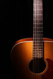 Acoustic guitar. Over black background Stock Photos