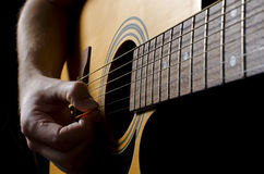 Acoustic guitar. Strumming an coustic guitar Royalty Free Stock Photography