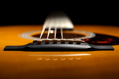 Acoustic guitar. Abstract across the bridge and saddle Royalty Free Stock Photos