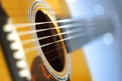 Acoustic guitar. With very shallow depth of field, focus on strings above sound hole Stock Photos