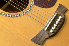 Acoustic guitar. Close-up guitar body with sound hole and strings royalty free stock photos