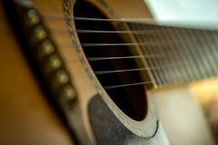 Acoustic guitar. Close-up guitar body with sound hole and strings stock photos