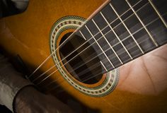 Acoustic guitar. A closeup of the frets and hole on a acoustic guitar Stock Photo