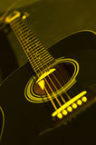 Acoustic guitar. Standing on a dark background stock images