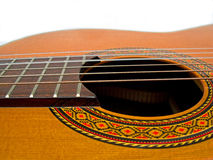 Acoustic Guitar. Close up of strings, wood, finger board, hole and graphics Stock Photos
