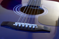Acoustic guitar. Close up on an acoustic guitar Royalty Free Stock Image