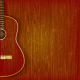 Acoustic guitar on abstract grunge background Royalty Free Stock Photos