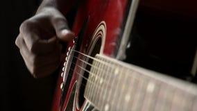 Acoustic guitar. In musician hands