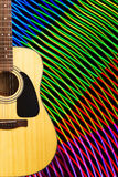 Acoustic guitar against abstract background Royalty Free Stock Photos
