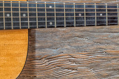 Acoustic guitar against a wooden background with copy space Royalty Free Stock Images