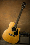 Acoustic guitar and amplifier Stock Images
