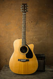 Acoustic guitar and amplifier Royalty Free Stock Photo