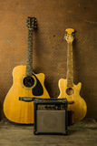 Acoustic guitar and amplifier Royalty Free Stock Image